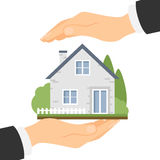 Hands protect home. Concept of house insurance, protection and safety. Insurance agency Stock Photography