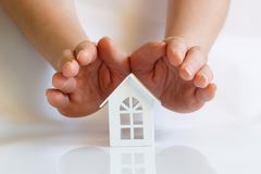 Hands protect house . The concept of protection and property insurance royalty free stock photos