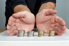Hands protect money. Hands protect Euro coins money Royalty Free Stock Photo