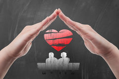 Hands protecting couple and heart shape Royalty Free Stock Photography