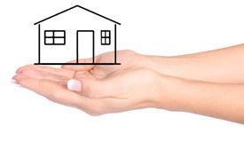 Hands protecting drawn house Stock Images