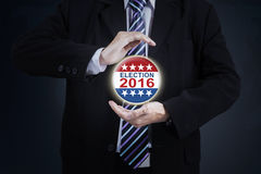 Hands protecting election 2016 symbol Royalty Free Stock Photography