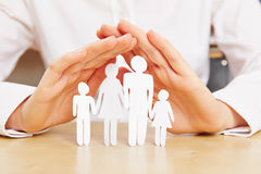 Hands protecting family Royalty Free Stock Photos