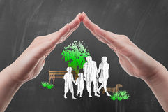 Hands protecting family silhouettes Royalty Free Stock Image