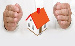 Hands protecting house Stock Photos