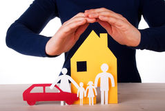 Hands Protecting House, Family and Car. Two Hands are Protecting a Family infront of its House with their Car, Isolated