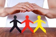 Hands protecting people Stock Image