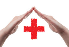 Hands protecting red cross concept Royalty Free Stock Photo