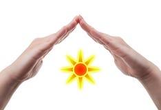 Hands protecting the sun Stock Photos