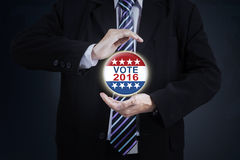 Hands protecting a vote symbol Stock Images