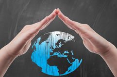 Hands protecting world or earth shape Royalty Free Stock Photography