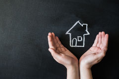 Hands protects a house Royalty Free Stock Photos
