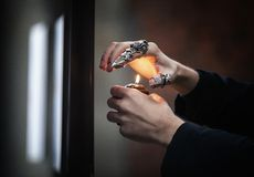 Hands of a psychic with a candle in the process of ritual royalty free stock image