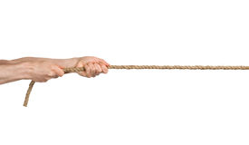 Hands pull a rope. Royalty Free Stock Image