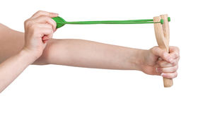Hands pull rubber band of slingshot isolated Stock Photos