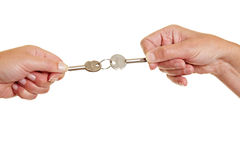 Hands pulling keys Stock Photos