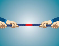 Hands Pulling On Rope During game of tug of war. Business competition. Royalty Free Stock Photo
