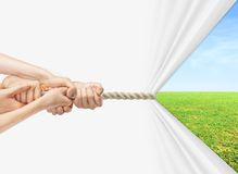 Hands pulling rope. To field royalty free stock images