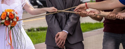 Hands pulling rope. Tug-of-war stock photography