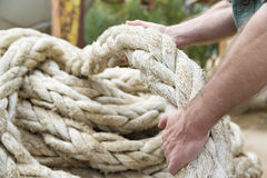 Hands pulling rope. Two hands pulling a big rope of ship royalty free stock images