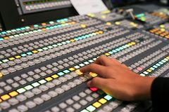 Hands push a button of Switcher buttons in studio TV station, Au. Dio and Video Production Switcher of Television Broadcast Royalty Free Stock Images