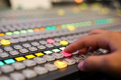 Hands push a button of Switcher buttons in studio TV station, Au. Dio and Video Production Switcher of Television Broadcast Royalty Free Stock Photos