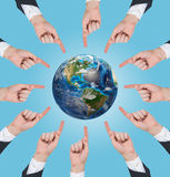 Hands pushing at earth Stock Photography