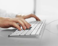 Hands pushing keyboard Stock Images