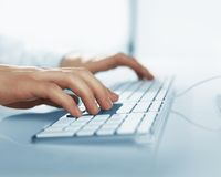Hands pushing keys of computer Royalty Free Stock Photos