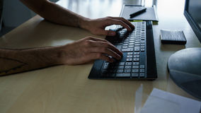Hands pushing Keys. With Graphic Tablet in Background Stock Photo