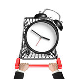 Hands pushing shopping cart with alarm clock Stock Image