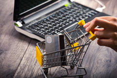 Hands pushing supermarket trolleys Royalty Free Stock Photography