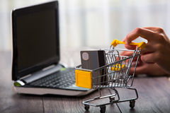 Hands pushing supermarket trolleys filled with credit hard Royalty Free Stock Image