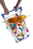 Hands pushing supermarket trolleys filled with pills Stock Photography
