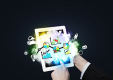 Hands pushing the tablet's screen. Digital analytics solutions. Stock Image