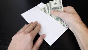 Free Hands Put American One Hundred Dollar Bills From Envelope. Man Holding Cash Money. Male Counts Dollars. Successful Business Concep Stock Photos - 174426753