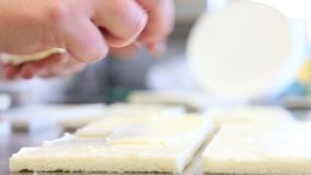 Hands put the cheese in the sandwich stock video