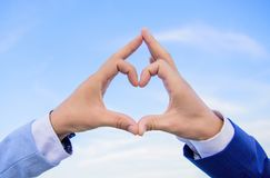 Hands put together in heart shape blue sky background. Love symbol concept. Male hands in heart shape gesture symbol of. Love and romance. Hand heart gesture royalty free stock photos