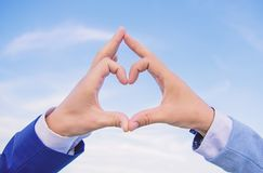 Hands put together in heart shape blue sky background. Love symbol concept. Male hands in heart shape gesture symbol of. Love and romance. Hand heart gesture stock photography