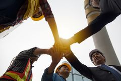 Hands put together to show unity and cooperation. To celebrate success royalty free stock photos