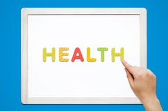 Hands put the word Health with magnetic letters Royalty Free Stock Photos