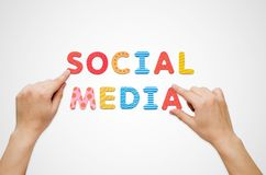 Hands put the words Social Media with magnetic letters Stock Images