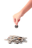 Hands putting coins isolated on white background Royalty Free Stock Photo