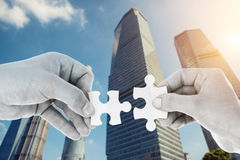 Hands putting partnership puzzle pieces together Royalty Free Stock Photo