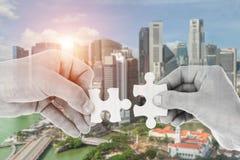 Hands putting partnership puzzle pieces together Stock Photos