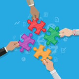 Hands putting puzzle pieces together. Royalty Free Stock Photo