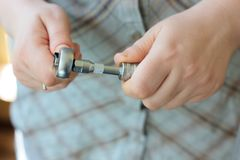 Hands putting ratchet on a socket wrench. Hands putting ratchet on a socket wrench Stock Photos