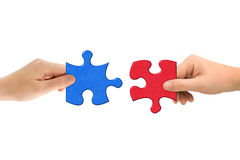 Hands and puzzle Stock Photography