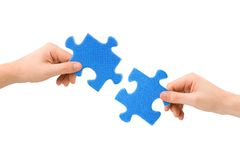 Hands and puzzle Royalty Free Stock Photography