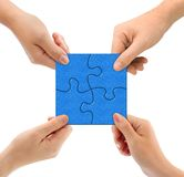 Hands and puzzle. Isolated on white background stock images